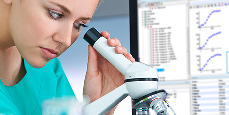 Scientist using microscope for analysis